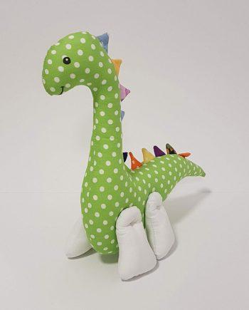 """Играчка от плат динозавъра """"Мърфи"""". Шита играчка динозавър, подходяща за бебета и малки деца. Изработена от памучен плат с пълнеж силоконов пух, лицето е рисувано с безвредни текстилни бои. Напълно безопасна за бебета и малки деца, няма опасни части и елементи. С възможност за персонално изписване на името на детето. Размер: 29х11х28 см. Поддръжка: За да се запази по-дълго време Вашата играчка не перете в пералня над 40 градуса и не сушете в сушилна машина. Продукта е единична бройка. При изчерпване има възможност да се изработи отново, но имайте предвид, че може да има малки разлики. Срок за изработка: 3-4 работни дни."""